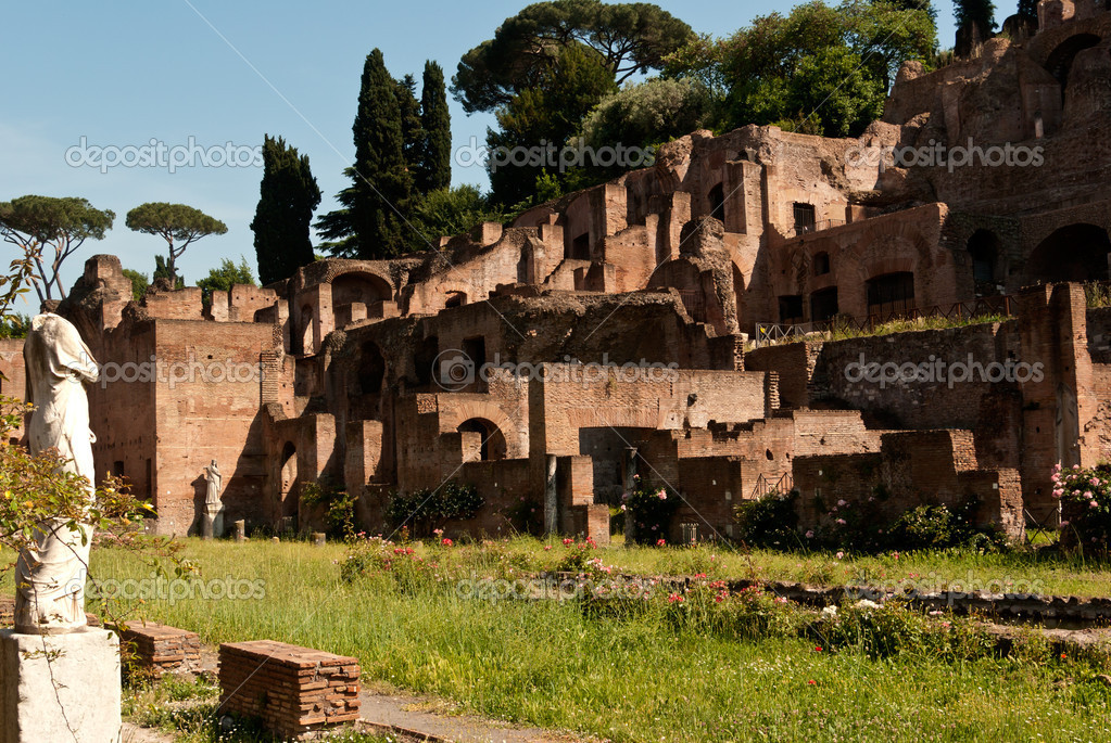 Ruins of the ancient Rome accompanied by a white statue and a lot of trees  Stock Photo #5841461