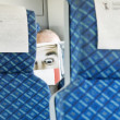 Stock Photo: Paper Face MReading Paper on Train