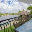 Balcony entertainment area of waterfront house — Stock Photo #5786266