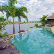 Stock Photo: Waterfront Mansion with Pool and Bali hut overlooking the canal