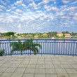 Foto Stock: Balcony views from waterfront Mansion overlooking canal