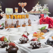 Asian Fusion appetizers and desserts on table — Stock Photo