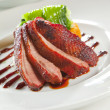 Royalty-Free Stock Photo: Oven crisp duck breast marinatedin a Peking duck style sauce on