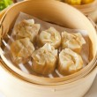 Stock Photo: Dumplings in bamboo steamer