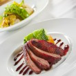 oven crisp duck breast marinatedin a peking duck style sauce on — Stock Photo