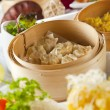 Dumplings in bamboo steamer — Stock Photo