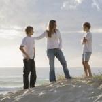 Family at the beach early morning — Stock Photo #5788281