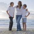 Family at the beach early morning — Stock Photo