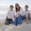 Family at the beach early morning — Stock Photo #5788294