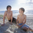 Two young brothers at the beach — Stock Photo #5788695