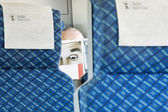 Paper Face Man Reading Paper on Train — Stock Photo