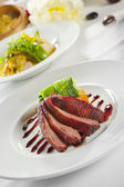 Oven crisp duck breast marinated in a Peking duck style sauce on — Stock Photo
