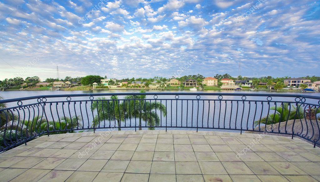 Balcony views from waterfront Mansion overlooking the canal — Stock Photo #5786379