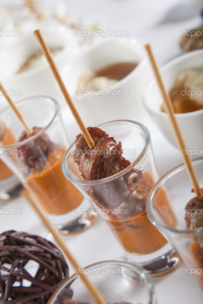 Asian Fusion lamb on stick in shot glass with sauce — Stock Photo #5788135