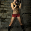 Female model boxing in basement - Photo