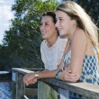 Two girls looking out from viewing platform by the creek — Stock Photo #5791939