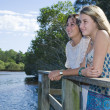 Two girls looking out from viewing platform by the creek — Stock Photo #5791946