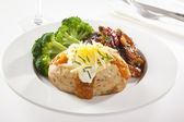 Baked Potato with steak and broccoli — Stock Photo