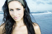Beautiful young model on beach — Stock Photo
