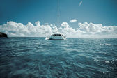 Katamaran on calm green shallow waters — Zdjęcie stockowe