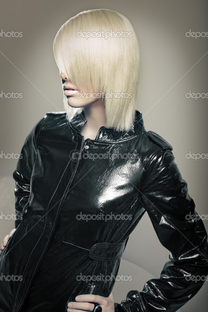 Beautiful young blond fashion model with leather jacket. beauty shot of Hair.  Stock Photo #5791239
