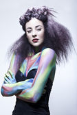 Brunette model in studio with body paint — Stock Photo