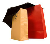 Shopping bags with umbrella — Stock Photo