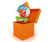 Funny clown jumping from a box — Stock Photo