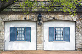 Classic European Garage with blue shutters — Stock Photo
