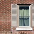 Stock Photo: Traditional window with wooden shutters.