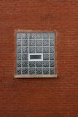 Industrial Red Brick Wall with Blue Glass Block Window — Stock Photo