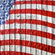 Old Painted American Flag on Dark Wooden Fence - Foto Stock
