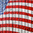 Old Painted American Flag on Dark Wooden Fence -  