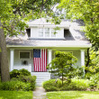 American Home with flag - Zdjcie stockowe