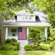 American Home with flag - Stock Photo
