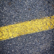Foto de Stock  : Asphalt Background with yellow stripe