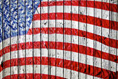 Old Painted American Flag on Dark Wooden Fence — Stock fotografie
