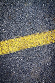 Asphalt Background with yellow stripe — Stock Photo