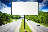 Billboard with Stormy Sky on american toll way — Stock Photo