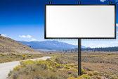 Billboard on country road — Foto Stock