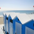 Blue beach huts — Stock Photo #5963901