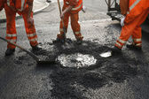 Asphalt workers — Stockfoto
