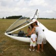 Stock Photo: Glider pilot and family