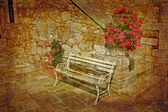 Old bench in nice patio — Stock Photo