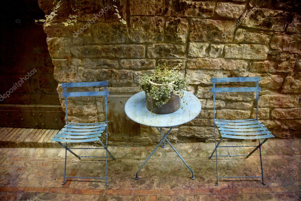 Artistic work of my own in retro style - Postcard from Italy. - Alley with table for two, Spello, Umbria, Italy — Stock Photo #6089799