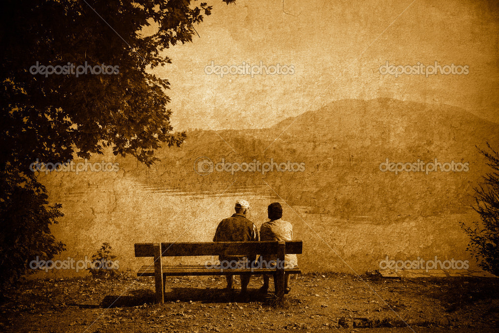 My grandmother and grandfather by the lake -  Cross processed.  Stock Photo #6574283