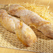 Freshly baked spicy baguette on table - Foto Stock