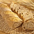 Freshly baked bread and wheat on table - Foto Stock