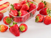 Fresh juicy strawberries on a wood tray — Stock Photo