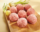 Minced delicatessen meat. Arrangement on a cutting board. — Stock Photo